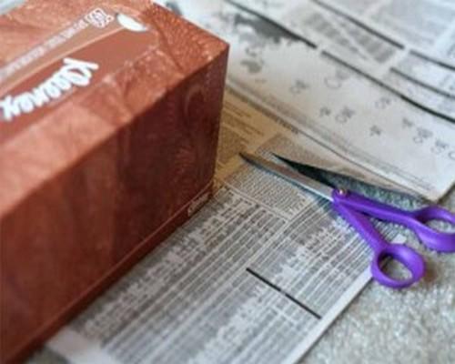 Cutting Newspaper