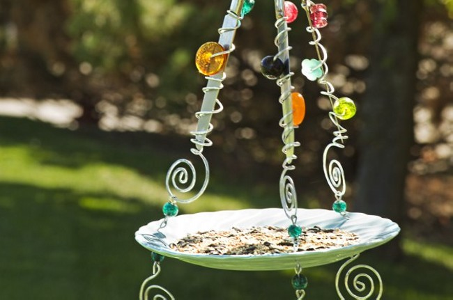 Diy recycled bird feeders recycled things for How to make a bottle bird feeder