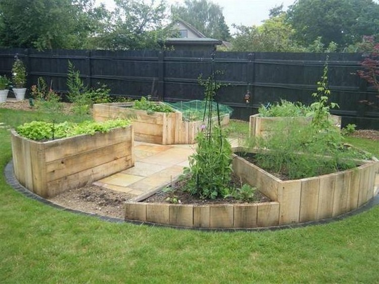 Wood pallet raised garden beds recycled things for Attractive raised vegetable beds
