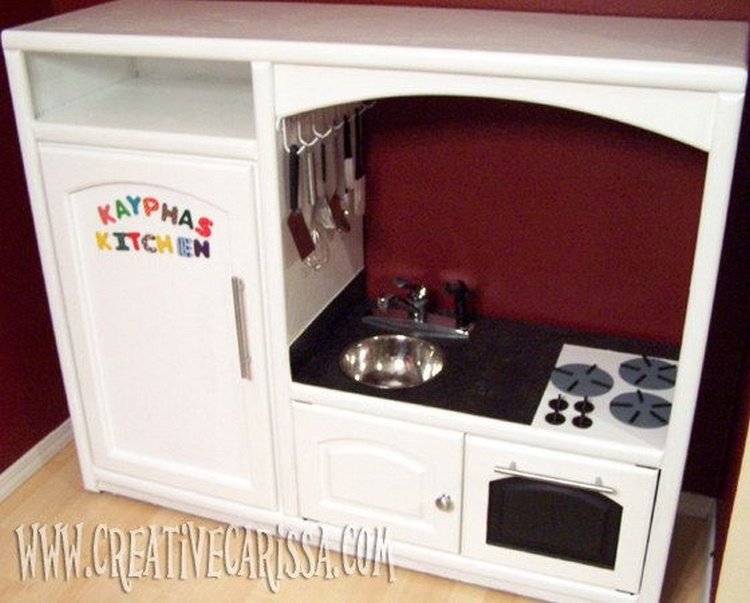 Entertainment center converted into play kitchen