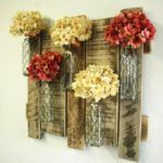 Pallet Wall decor with Chicken Wire Bottles