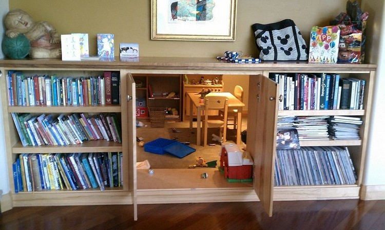 Secret Playroom Built into a Cabinet in a Bookshelf